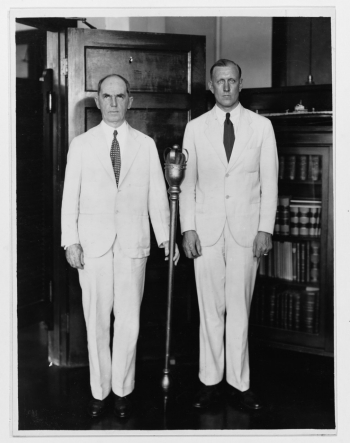 Rear Admiral William D. Leahy, USN (left), and his aide, Lieutenant Commander Ernest H. Von Heimburg, with a historic Canadian mace.