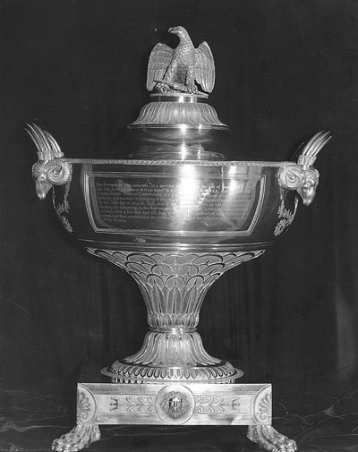 Silver urn presented to Captain Isaac Hull, USN, By the citizens of Philadelphia, Pennsylvania, in recognition of his 19 August 1812 victory over HMS Guerriere while in command of USS Constitution. The urn was made by Philadelphia silversmiths Thomas Fletcher and Sidney Gardiner, and engraved by W. Hooker. This view shows the urn's obverse side, with presentation inscription. The urn was loaned to the Navy in 1911 by Dr. Isaac Hull Platt. In 1982 it was transferred to the USS Constitution Museum, Boston, Massachusetts. Photographed 3 September 1964 by B.L. Mason. U.S. Naval Historical Center Photograph. Photo #: NH 48964 .