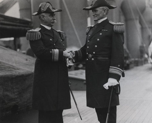 Rear Admiral Cameron M. Winslow (at left), being relieved by Rear Admiral William B. Caperton, as CINCPACFLT on 28 July 1916 aboard USS Pittsburg (CA-4). Photographic Section, Naval History and Heritage Command, #NH83774.