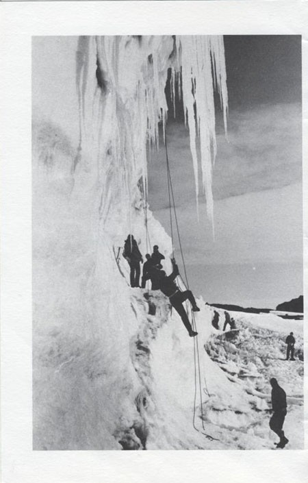 Image of figures scaling ice.