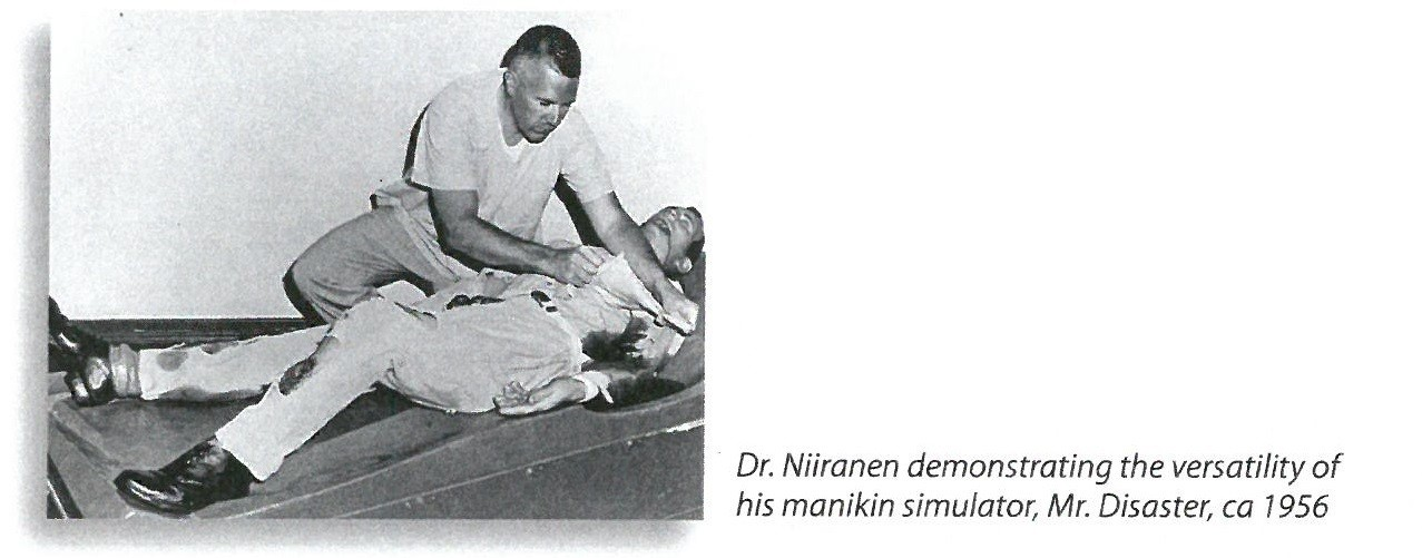 jpeg photo showing Dr. Niiranen demonstrating  the versatility  of his manikin simulator, Mr. Disaster, ca 1956