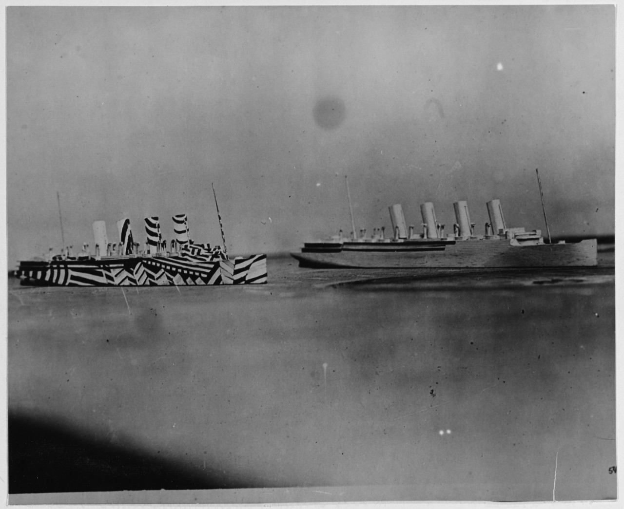 Photograph of a camouflaged ship