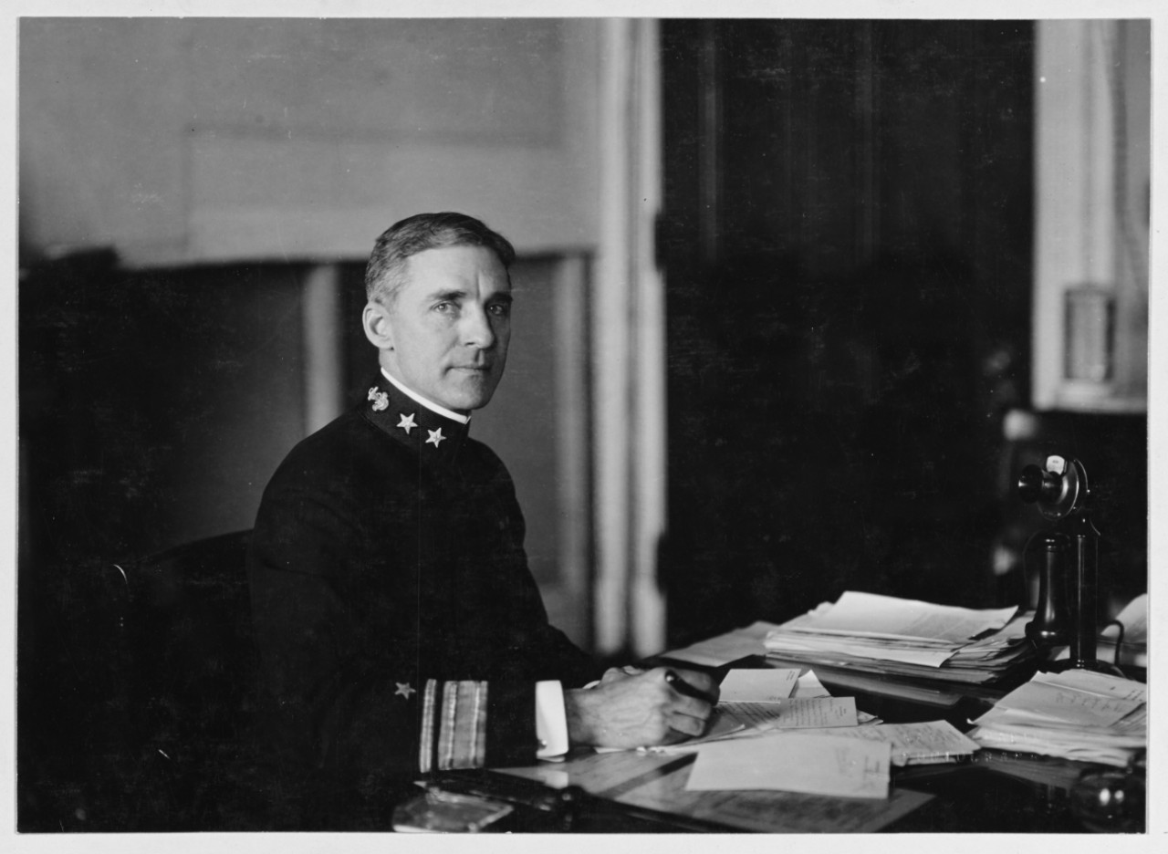 black and white photograph of Rear Admiral Palmer seated at his desk