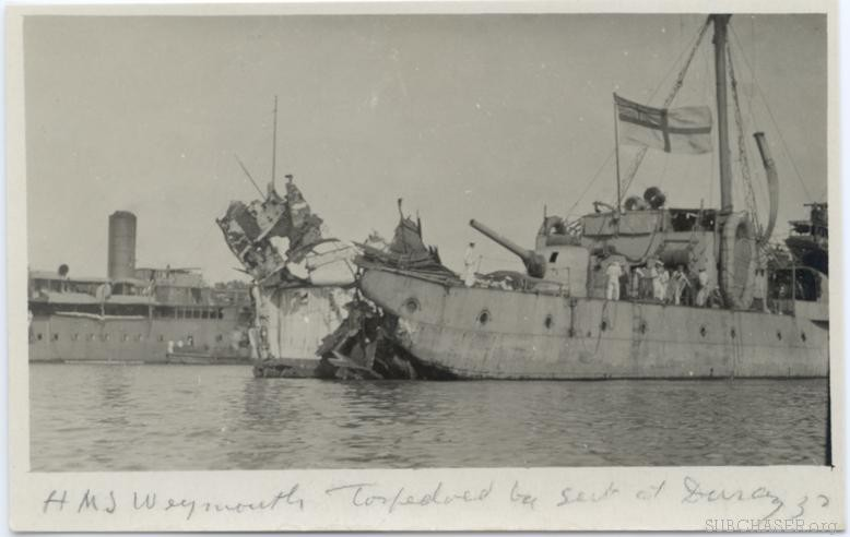 Photo of ship with torpedo damage
