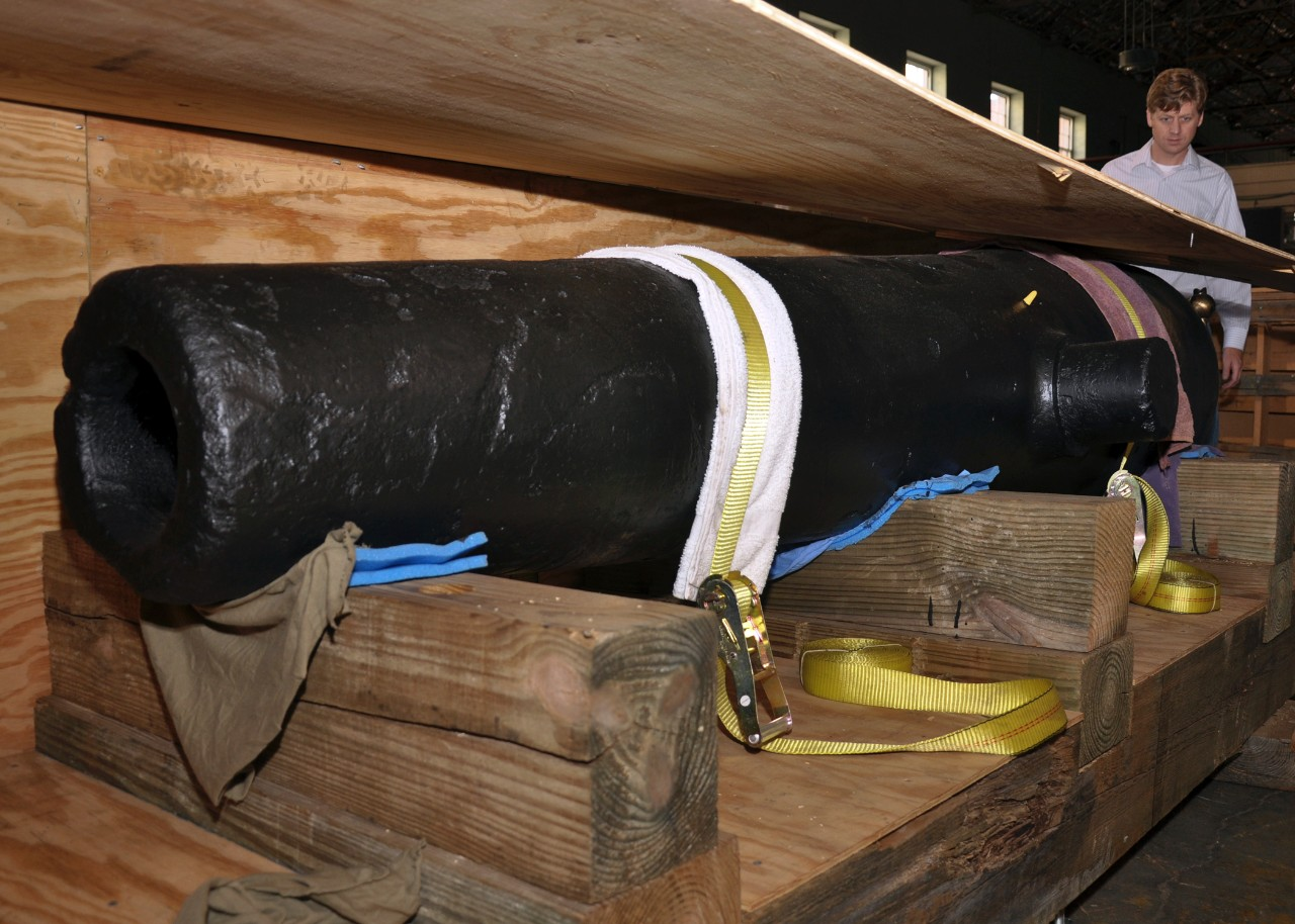 A 32-lb cannon recovered from the wreck of the Confederate sloop-of-war CSS Alabama is seen at the Naval History and Heritage Command laboratory warehouse.