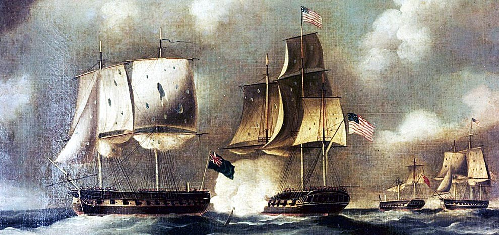 Two wooden warships with torn sails in battle while at sea. Ship on right shows the American Flag and ship on left shows the British flag.