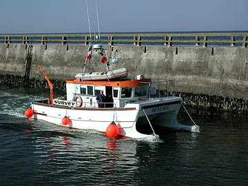 Figure 1: Survey vessel Genesis leaves the harbor at Grandcamp-Maisy, France.