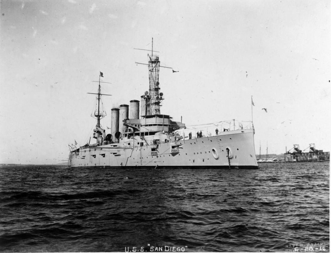 Black and white photo of steel ship, USS San Diego, in the water.