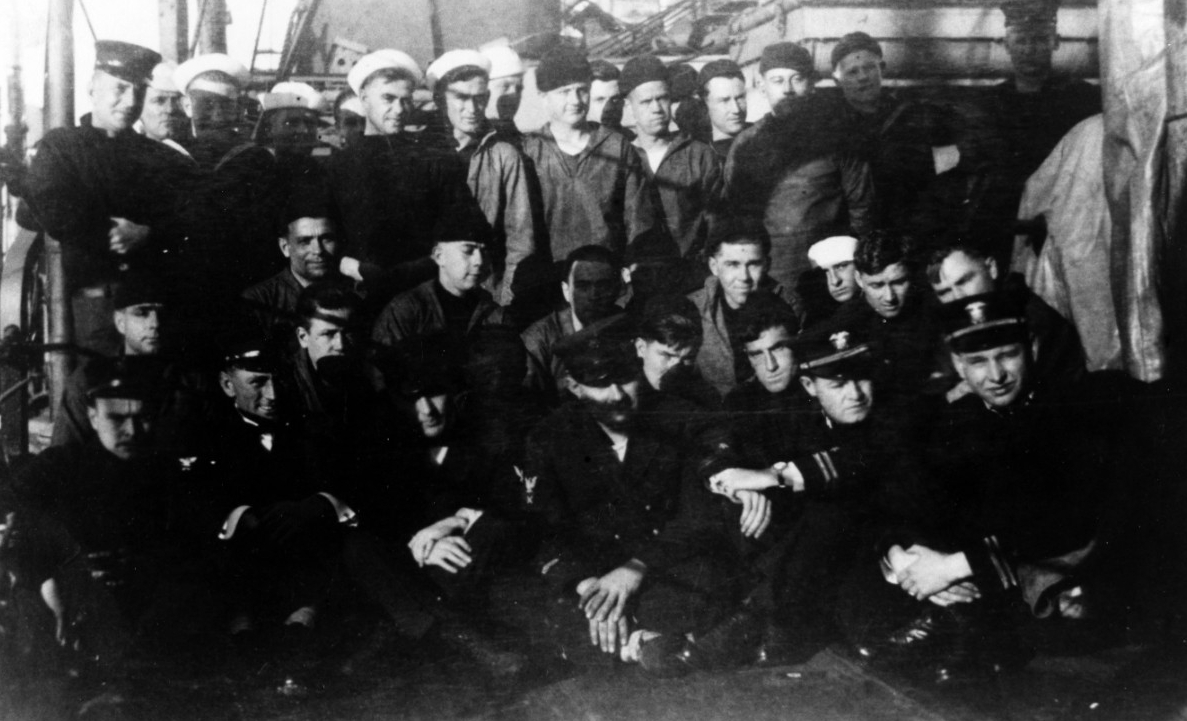 Black and white image of US Navy sailors on a ship deck. These sailors were just rescued from the sinking USS Jacob Jones.